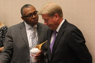 Ald. Howard Brookins Jr. and Corporation Counsel Stephen Patton discuss the latest Jon Burge settlements before Friday's Finance Committee meeting.