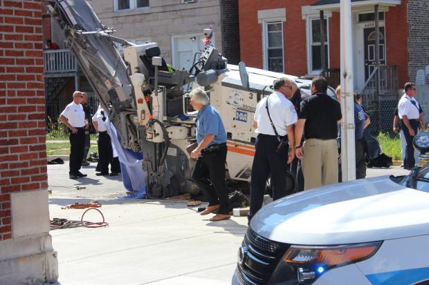 A construction worker died after being trapped underneath a machine in Englewood Thursday, officials said.