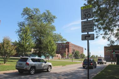 A speed limit sign posted at Damen Avenue alerts drivers about the Pershing Road speed camera zone.