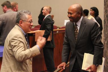 Commissioner Daniel Sih talks with Norfollk Southern Vice President Frederick Blair Wimbush after Thursday's Plan Commission meeting.