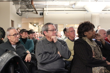 Ald. Pat Dowell (3rd) joins hundreds of residents at a South Loop community meeting to discuss development of the city's Motor Row District, including talk of a possible DePaul Arena and a new access road to Lake Shore Drive.