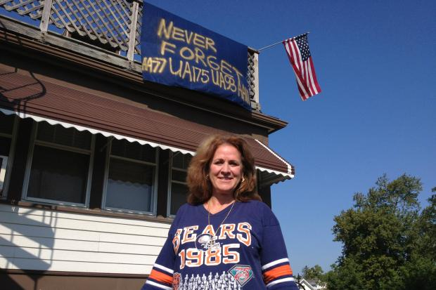 Desiree Luburich of Norwood Park has a banner on the east side of her home that honors the victims of 9/11.