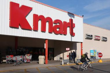 Customers leave a Kmart in Chicago in 2011. (File photo).