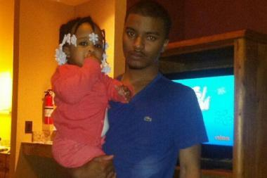 "Family said slain man Marcus Rush's one-year-old daughter Jamiyah was ""his heart."""
