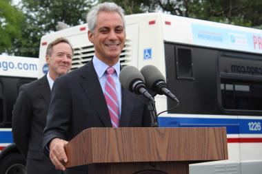 Mayor Rahm Emanuel came to the aid of a cyclist knocked down in a collision with a truck Tuesday.