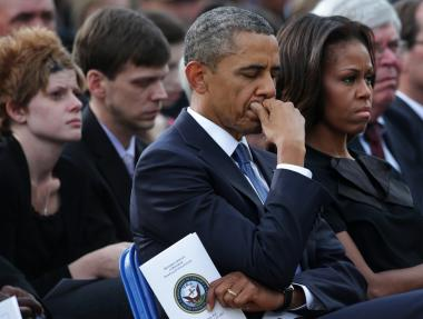 President Barack Obama and first Lady Michelle Obama at a memorial service at the Navy Yards in Washington DC on Sunday.