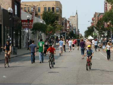 A group of children ride their bikes down Milwaukee Avenue in the Wicker Park neighborhood at last year's Open Streets event.