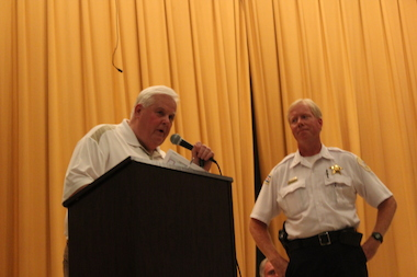 Ald. Tim Cullerton (38th), left, and Jefferson Park Police District Cmdr. James O'Donnell address a crowd of Portage Park residents concerned about a spate of shootings last summer.