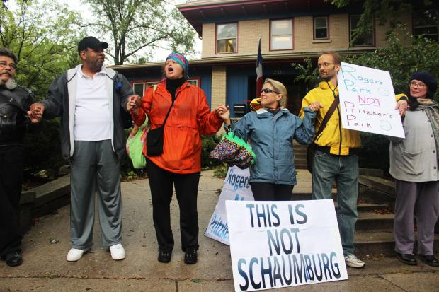 Protesters braved the rain Sunday to march on Sheridan Road in opposition to a proposed 250-car parking garage.