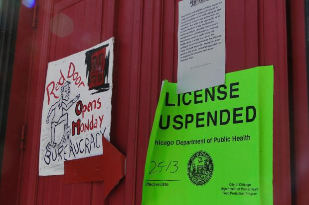The city's Health Department shut down Red Door at 2118 N. Damen Ave. Wednesday. The restaurant failed a reinspection Friday and is hoping to reopen this week after another inspection, according to a sign on its door.