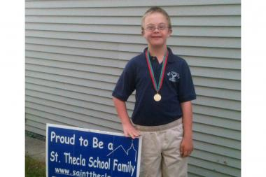 St. Thecla Catholic School eighth-grader Sean Nelson is the first student with Down syndrome in the history of the school, which was founded in 1927. He is scheduled to graduate at the end of this school year, and he has been a St. Thecla student since kindergarten.