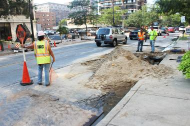 Crews stand last year near the site of a broken water main in the 6100 block of North Sheridan Road.