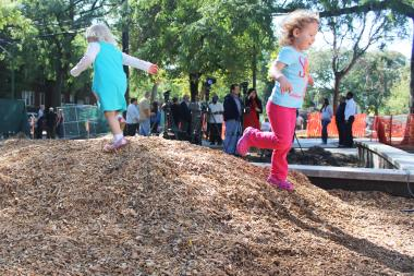 Keira Englund-Kenealy, 3, (left) and Penny Blocher, 3, play in Touhy Park during a press conference to announce its renovation last year.