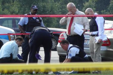 Police on the scene of a homicide in Washington Park in 2013. Chicago saw the most homicides of any city in 2012, according to data from the FBI.