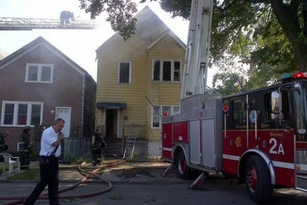 A man jumped from a second-floor window to escape a home fire in West Garfield Park Tuesday, officials said.