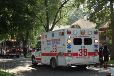 A woman was found stabbed multiple times in a burning building in Brighton Park.