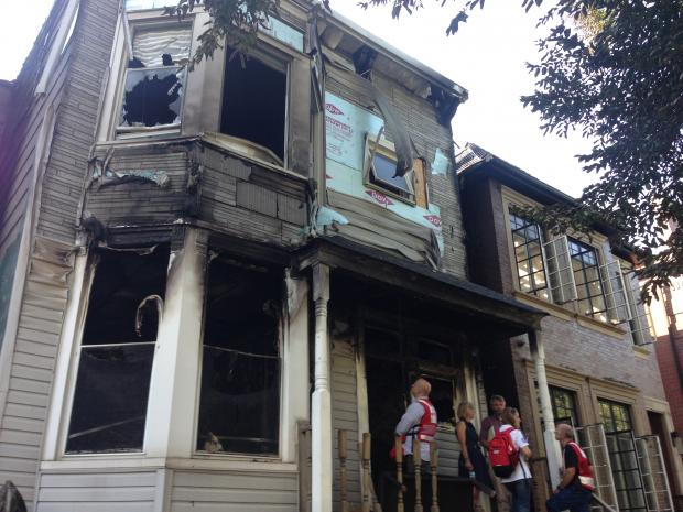A fire in a 2½-story building in the 3600 block of North Wayne Avenue left one firefighter injured Tuesday, officials said.