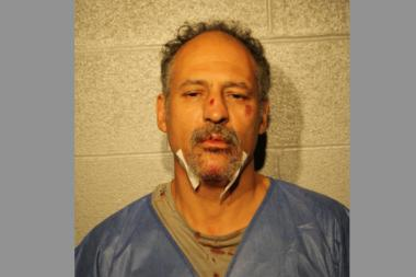 Freddy Feliciano allegedly spat blood in an officer's face Saturday afternoon after attacking a senior citizen.