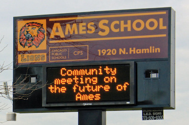 An Ames Middle School sign announces a community meeting about converting the school to a military school, Nov. 1, 2012.