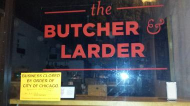 "The Butcher & Larder, 1026 N. Milwaukee Ave., has a ""business closed"" sticker on its window."