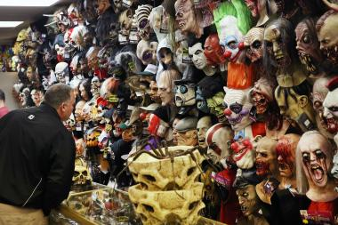 A customer checks out some last-minute Halloween costumes in a Chicago store.