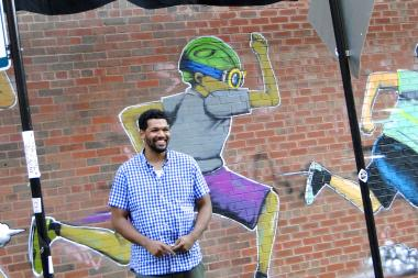 Artist Hebru Brantley in front of a new mural on the southern wall of Nike's new store at 1640 N. Damen Ave.