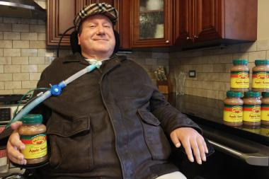 Former Chicago cop Jim Mullen was paralyzed below the neck when a gunman opened fire in 1996 in Rogers Park. He's since launched a business distributing applesauce.