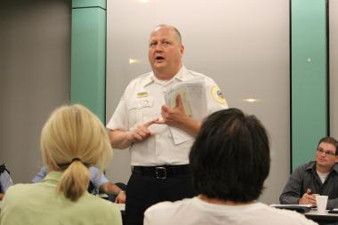 Town Hall Police Cmdr. Elias Voulgaris speaks to residents at a CAPS meeting in Lakeview.