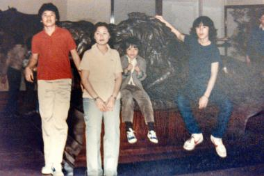 Lei Keovan (second from r.) poses with three of his siblings, including older brother, Matt Keovan (r.). Lei came to the United States when he was 5 years old. Originally from Laos, Lei's family fled the country when he was 2½ years old for a refugee camp in neighboring Thailand. A synagogue in Oak Park sponsored Lei's immigration to the United States. He currently lives in Montclare, owns his own law firm in Avondale and coaches the Collins Academy High School girls volleyball team in North Lawndale.
