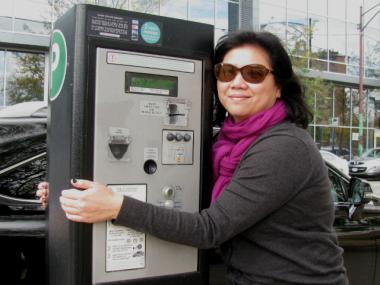 Mindy hugs a parking pay box in Lincoln Park. She may not have gotten a ticket Sunday if she'd fed it, too.