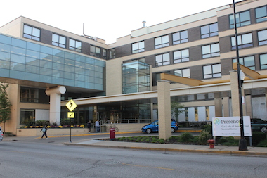 "Officials at Our Lady of the Resurrection are considering closing the Portage Park hospitals, but opponents said that would turn Portage Park into a ""health care desert."""