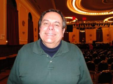 Saul Osacky, owner of the Logan Square Auditorium, said he intends to buy a gun.