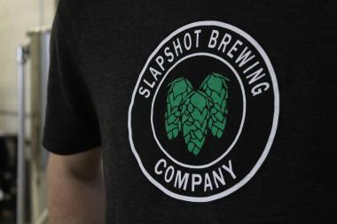 Steve Miller's SlapShot Brewery shirt. Miller said he hopes to be brewing onsite by the end of the month.