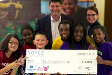 Mike Kennedy and Rebecca Daugherty with kids at Science Club, which won an award and $10,000 for its work in Uptown.
