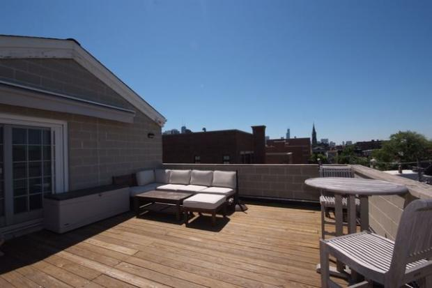 The asking price for a penthouse duplex with a private roof deck dropped more than $50,000 in October.