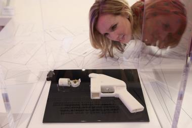 A woman looks at a gun constructed from a 3-D printer in London earlier this year.