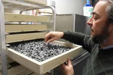Matthias Merges looks over a batch of house-made squid ink pasta at A10. The restaurant will join seven others for a June 24 restaurant crawl on 53rd Street.