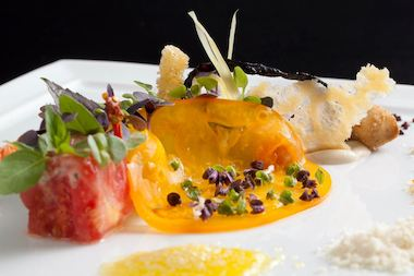 A tomato dish at Lincoln Park's Alinea, which was bestowed the Michelin Guide's highest three-star rating.