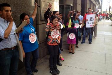 Ames parents protest in front of CPS headquarters Wednesday.