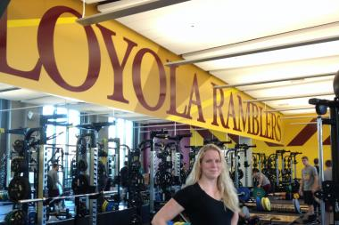 Angie Sorensen, the Director of Sports Performance at Loyola University Chicago, poses in the school's weightlifting room for student-athletes. Sorensen is part of the some 3 percent of Division I strength trainers who are female.