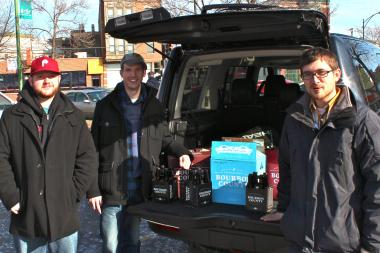 Adam Freid, left, David Kulda and Jimmy Schultz show off their haul from last year's Binny's Black Friday beer release.