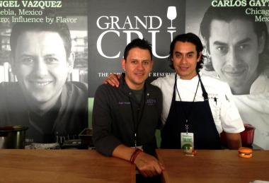 Mexique's Chef Carlos Gaytan (right) poses with Angel Vazquez.  Gaytan's Chicago Avenue restaurant received a Michelin star for the second consecutive year.