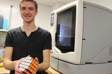 Dane Christianson, 20, a mechanical engineering major at the Illinois Institute of Technology, shows off the X-Cube, a puzzle he created.
