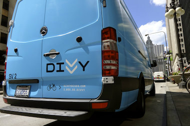 "Divvy ""rebalancers"" drive bicycles from docking stations that overflow to stations that empty quickly."