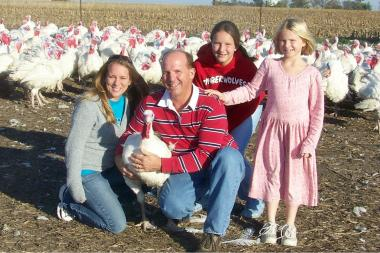 From left, Shawna, Robert, Kayla and Nicole Kauffman raise 70,000 turkeys on their farm in Waterman, Ill. each year. Most birds are sold fresh just before Thanksgiving.