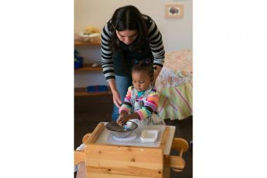 Teacher Lorena Billups works with 2-year old Scarlett Williams in a Toddler Community class organized by the Humboldt Park Montessori School board last school year.