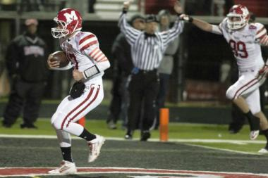 Marist quarterback Jack Donegan scores a rushing touchdown during the RedHawks' 21-7 victory over Bolingbrook in a Class 8A second round playoff game. Marist hosts Oswego at 7 p.m. Saturday in the state quarterfinals.