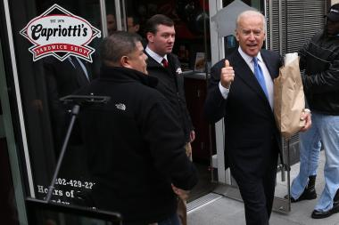 Vice President Joe Biden, seen here attending the opening of a new sandwich shop in Washington, D.C. Thursday, will be in Chicago Monday to help break ground on a new domestic violence shelter.