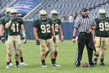 St. Patrick High School's Joe Haniacek (92) is ready to line up against Mount Carmel at Soldier Field. Haniacek's father, John, was a captain on St. Patrick's football team.