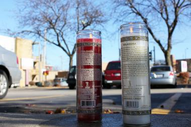 On Monday night, a 25-year-old man was fatally shot in a McDonald's parking lot, 4844 N. Lincoln Ave. On Tuesday, two candles stood where the man was slain.